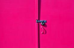Painted hut door. A brightly painted beach hut door Stock Image