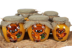 Painted jars of honey. Five painted jars of honey Stock Image