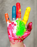 Painted kid hand Royalty Free Stock Photo