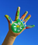 Painted kid hand. With flower daisy stock image