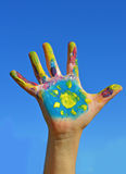Painted kid hand. With sun royalty free stock photography