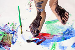 Painted Kid's Feet on Art Project Royalty Free Stock Images