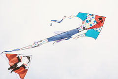 Painted kites flying Stock Photo