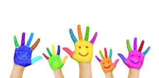 Painted lächelnde Hände. Stockfotografie