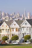 Painted ladies. Alamo Square, victorian architecture and San Francisco skyline stock photos