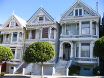 The Painted Ladies. A typical group of Victorian Houses in a hill in front of Alamo Square Royalty Free Stock Photography