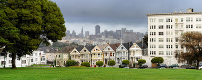 Painted Ladies of San Francisco. A row of Victorian houses, known as the Painted Ladies with downtown in the background as viewed from Alamo Square in San Royalty Free Stock Photography