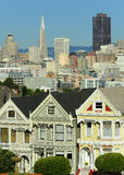 Painted Ladies of San Francisco. A row of Victorian houses, known as the Painted Ladies with downtown in the background as viewed from Alamo Square in San Stock Photography