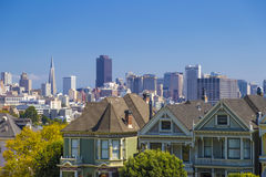 The Painted Ladies of San Francisco Alamo Square Victorian houses in San Francisco, California during clear sunny day and blue sky.  Stock Photo