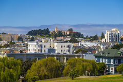 The Painted Ladies of San Francisco Alamo Square Victorian houses in San Francisco, California during clear sunny day and blue sky Royalty Free Stock Photos