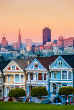 The Painted Ladies of San Francisco, California sit glowing amid Royalty Free Stock Image