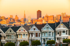 The Painted Ladies of San Francisco, California sit glowing amid Stock Photography