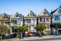 Painted Ladies Victorian Houses row at Alamo Square - San Francisco, California, USA. SAN FRANCISCO, USA - December 29, 2016:  Painted Ladies Victorian Houses Royalty Free Stock Photo