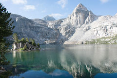 The Painted Lady at Rae Lakes in Kings Canyon National Park. The Painted Lady mountain reflected in the lake stock photography