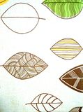 A painted leaf of a tree. A sheet of wood painted with brown paint on a piece of cloth. Dense arcs and veins of a leaf are densely drawn Stock Images