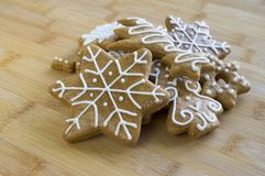 Painted light brown ginger breads, white icing, Christmas cookies, shapes - snowflakes, tree. Star, pile of biscuits Royalty Free Stock Images