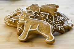 Painted light brown traditional czech ginger breads, white icing, Christmas cookies, shapes - snowflakes, stars, teddy bear royalty free stock photos