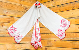 Painted linen towels in the red corner. Stock Photos