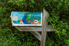 Painted mailbox with peacock Royalty Free Stock Image