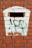 Painted mailbox at a red brick wall Stock Photography