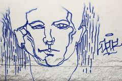 Street art of a male face in the Old town of Vilnius, Lithuania Royalty Free Stock Image