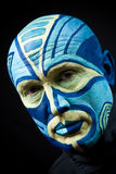 The painted man's face Stock Images