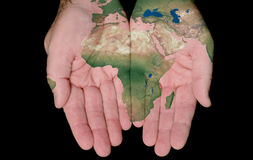 Painted Map Of Africa In Our Hands. Map Of Africa Painted On Hands Showing Concept Of Africa In Our Hands Stock Photo