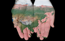 Painted Map Of Asia In Our Hands Royalty Free Stock Image