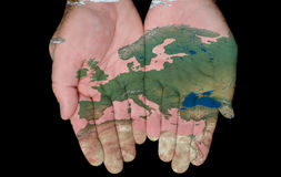 Painted Map Of Europe In Our Hands stock photography