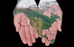 Painted Map Of North America In Our Hands. Map Of North America Painted On Hands Showing Concept Of North America In Our Hands Stock Photos