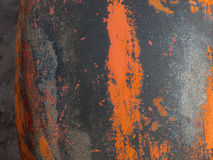 Painted metal background. In grays, blacks, oranges and rusts with rough texture Royalty Free Stock Images