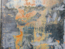 Painted metal background in grays and rusts. Painted metal background in gray with blacks and rusts, and a rough, peeling texture Stock Images