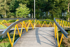 Painted metal footbridge over a small river in a Dutch nature ar Royalty Free Stock Photos