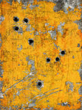 Painted metal with holes. Digital image of scratched metal painted yellow with holes stock images