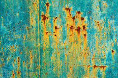 Painted metal surface with rust streaks Stock Photography