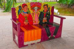 Painted Mexican wooden sofa. Portrait of a man, a woman and Katrin`s skeleton. Tulum, Riviera Maya, Yucatan, Mexico.  royalty free stock photo