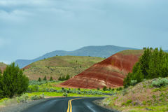 Painted mound seen from highway at John Day Fossil Beds. Driving along one of the highway`s that travels through John Day Fossil Beds National Park painted Royalty Free Stock Images