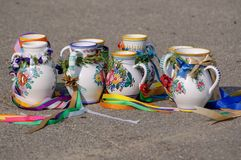 Painted mugs from the moravian feasts. On the ground the laid-painted mugs from the moravian feasts with ribbons Royalty Free Stock Image