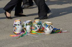 Painted mugs from the moravian feasts. On the ground the laid-painted mugs from the moravian feasts with ribbons.In the background dancers legs Royalty Free Stock Photos