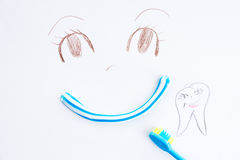Painted muzzle. Painted abstract muzzle, toothpaste and toothbrush Royalty Free Stock Photo