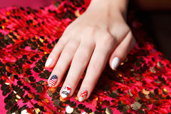 Painted nails with american symbols Stock Image