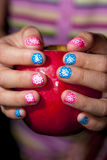 Painted nails and an apple Royalty Free Stock Photography