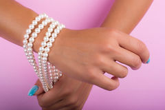 Painted nails and pearls Royalty Free Stock Photos