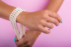 Painted nails and pearls Stock Photo
