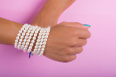 Painted nails and pearls Royalty Free Stock Images