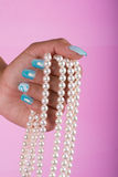Painted nails and pearls Stock Image