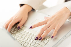 Painted Nails Typing Stock Photo