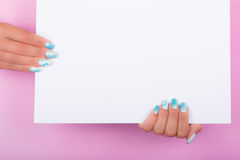Painted nails and white sheet Stock Images