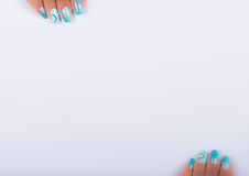 Painted nails and white sheet Royalty Free Stock Photos