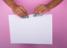 Painted nails and white sheet Stock Photography